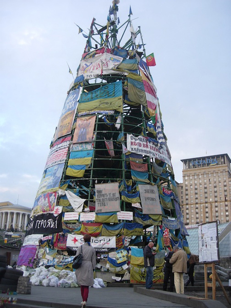 Illustration 11. A monumental tower constructed in Kieve's Maidan Square with posters from a range of Ukrainian political factions, including the ultra-right wing Svobada Party (April 2014). Photograph courtesy of Greg Sholette.