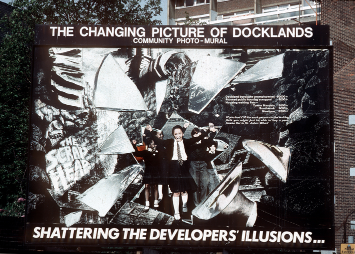 "Illustration 4. Shattering the Developers' Illusions, The seventh image from the first sequence of photo-murals each 18' x 12' (5.49m x 3.66m) from series ""The Changing Picture of Docklands."" exploring issues surrounding the re-development of the London Docklands from the viewpoint of local communities. © Peter Dunn and Loraine Leeson, Docklands Community Poster Project, 1982-5. Photograph courtesy of artist Loraine Leeson."