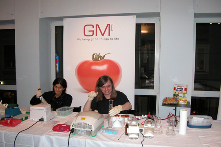 Illustration 9. Free Range Grain demonstration in Graz, Austria with Beatrice de Costa and Critical Art Ensemble's Steve Kurtz testing store bought food for genetically modified organism markers (2003).
