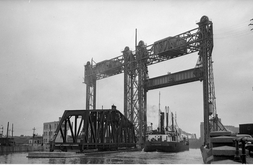[Image 7 - The swing and lift bridges, Peel Basin, Griffintown, 1943. The Wellington tower is visible at left behind the swing bridge. Source: Archives nationales du Canada, PA202868]