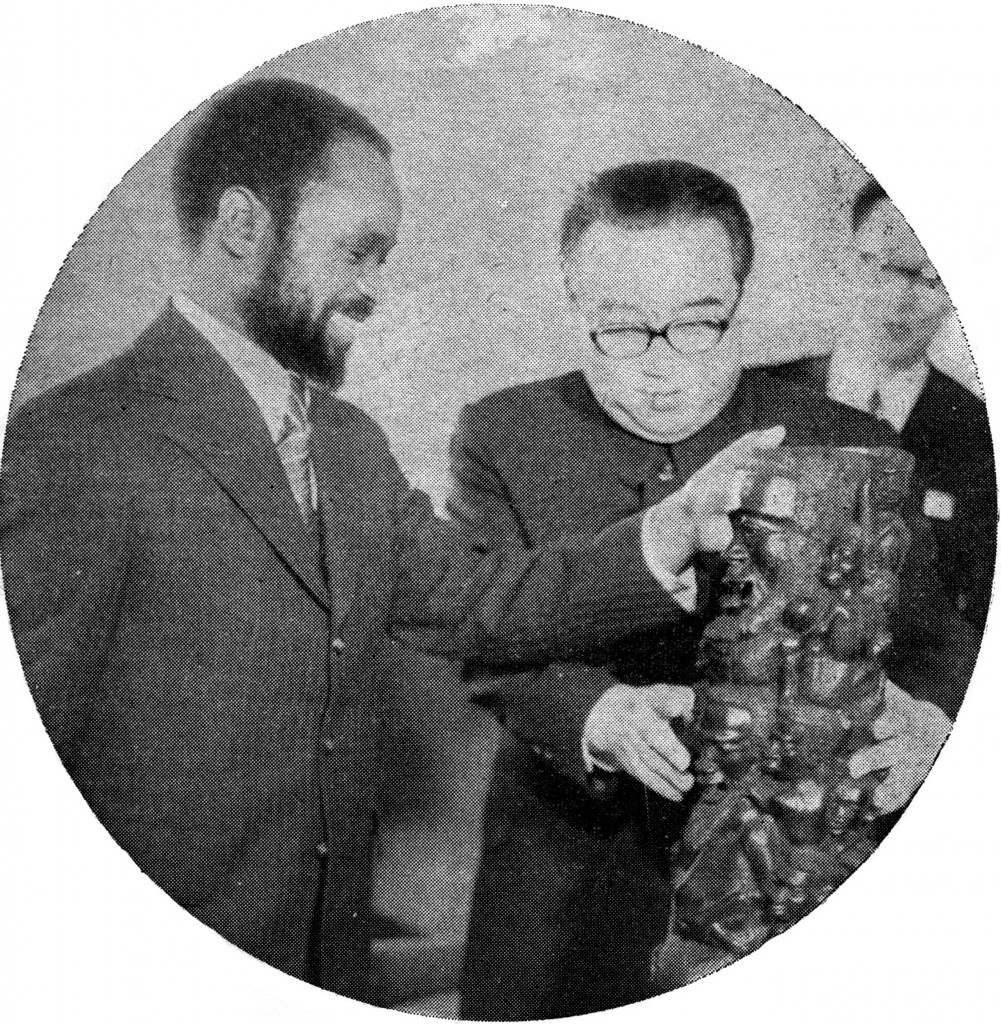 "[Image 2. Mozambican President presents Kim Il Sung with a blackwood sculpture of the ujamaa type. Photographer unknown, from: FRELIMO, Dept. of Information, ""Stronger Links with Socialist Countries,"" Mozambique Revolution (June 25, 1975): 3]"
