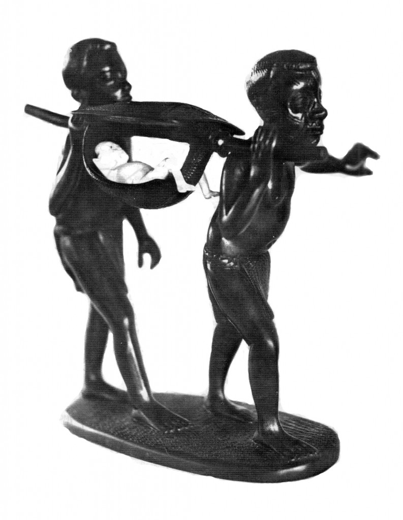 [Image 4. A blackwood and ivory sculpture, ca. 1970, created by an unknown Makonde artist depicting two Makonde men carrying a Portuguese colonist in a mashila. Photographer unknown, from: FRELIMO, Dept. of Information, Mozambique Revolution no. 45 (October-December 1970): back cover]