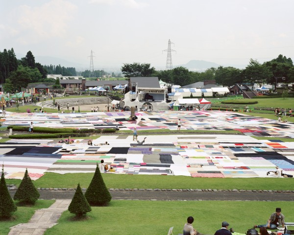 Segments of the giant furoshiki spread out for the outdoor concert Festival FUKUSHIMA! 2011, Fukushima City. Photo: SHIIGI Shizune