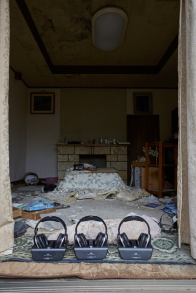 [Image 13. Meirō Koizumi, Home, 2015, collapsing house, audio track, headphones, solar panel. Installation view, Fukushima Prefecture, Japan, courtesy of Don't Follow the Wind.]