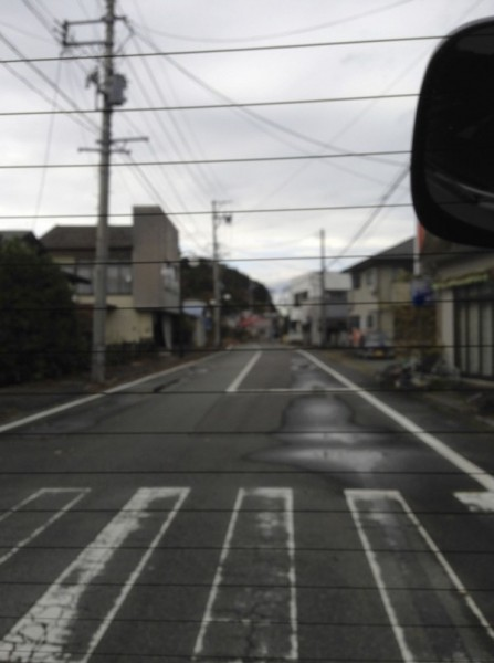[Image 7. An empty street inside the zone viewed from inside a car, November 10, 2015.]
